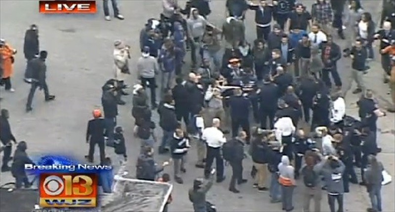 Police-and-protesters-scuffle-during-a-demonstration-in-support-of-Freddie-Gray-in-Baltimore-on-April-23-2015.-WJZ-TV-800x430