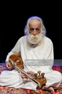 Iranian musician Mohammad Reza Lotfi on 'tar' (a double-bowl long-neck lute) performs at the World Music Institute 'Songs of the Persian Mystics' concert at Symphony Space, New York, New York, April 15, 2012. (Photo by Jack Vartoogian/Getty Images)