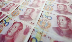 File photo taken in July 2015 shows 100 Chinese yuan bills. China sharply devalued the yuan for a second day on Aug. 12, 2015, with the central bank setting its daily reference rate for the yuan 1.6 percent lower than the previous day at 6.3306 per U.S. dollar, sparking concerns over financial-market volatility and a currency war in Asia. (Kyodo) ==Kyodo