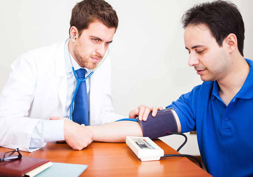 Doctor examining the blood pressure