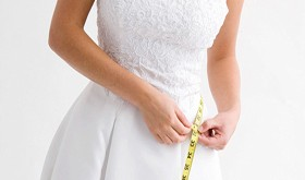 A872Y8 Bride measuring her waist