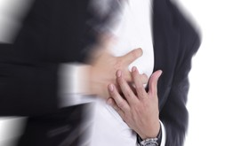 Heart Attack ,Use hand grabbing a chest with white background; Shutterstock ID 161797316; PO: aol; Job: production; Client: drone